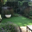 Garden with lawn and planting