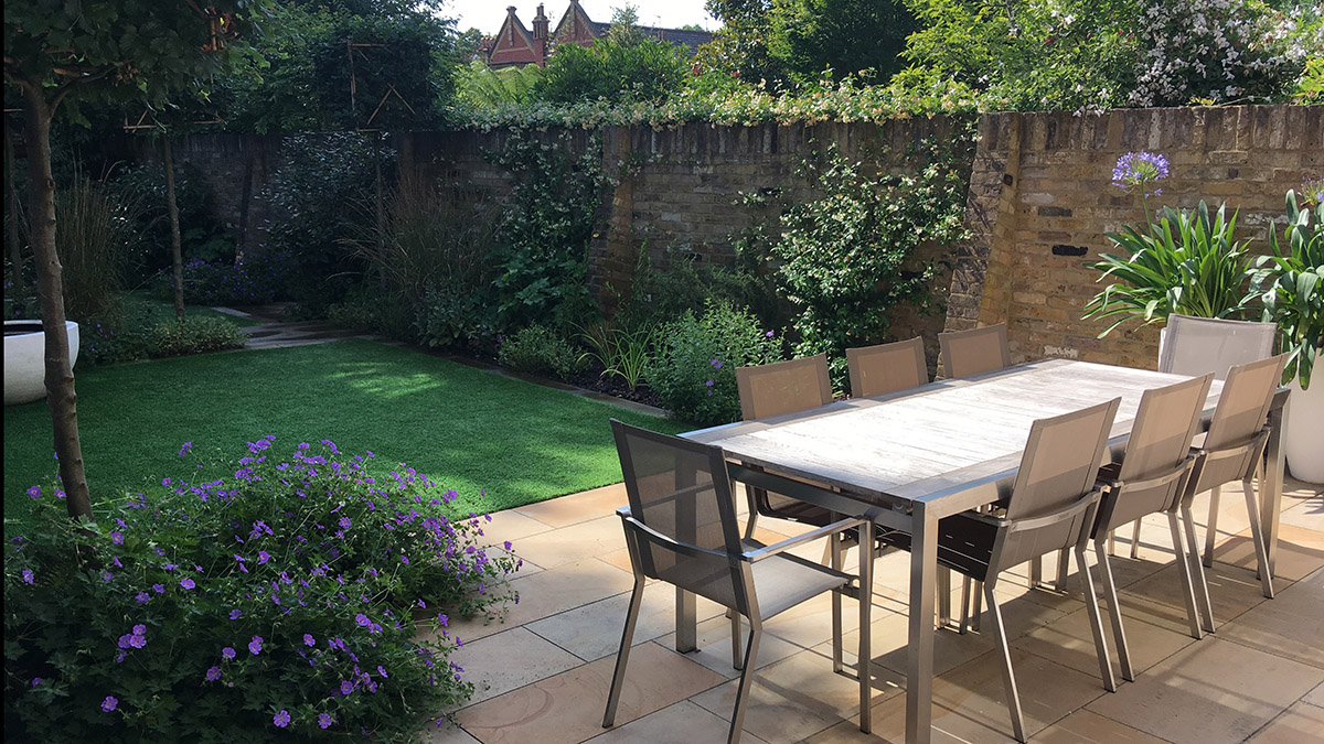 Garden dining terrace and lawn