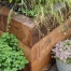 Urban cottage garden adding texture with with railway sleepers
